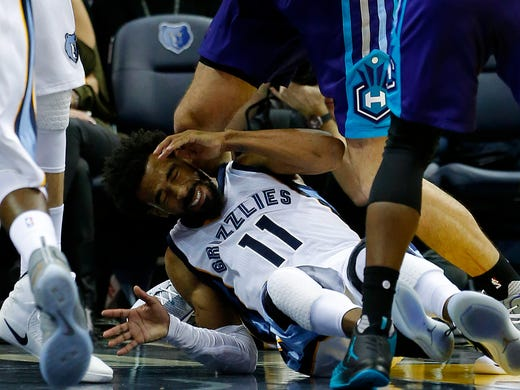 Memphis Grizzlies guard Mike Conley is hit in the back
