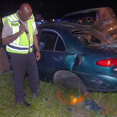 Opelousas police chief Donald Thompson at the scene of a three-vehicle collision that claimed the life of one person Friday night near Interstate 49 and U.S. 190.
