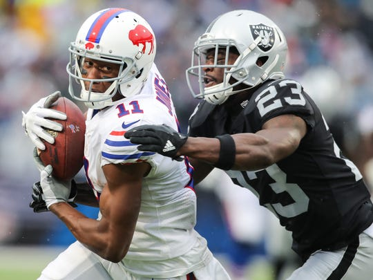 ORCHARD PARK, NY - OCTOBER 29:  Zay Jones #11 of the Buffalo Bills runs with the ball as Dexter McDonald #23 of the Oakland Raiders attempts to tackle him during the second quarter of an NFL game on October 29, 2017 at New Era Field in Orchard Park, New York.  (Photo by Brett Carlsen/Getty Images)