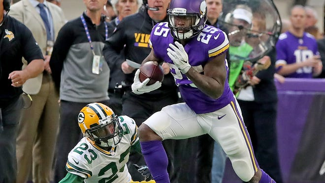 Green Bay Packers cornerback Damarious Randall (23) misses a tackle on against the Minnesota Vikings running back Latavius Murray (25) Sunday, October 15, 2017 in Minneapolis, Minn.