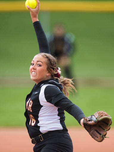 Cedar High School pitcher Kenzie Waters throws the