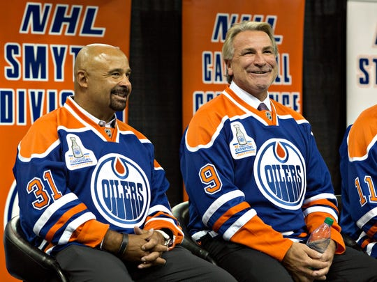 Former Edmonton Oilers' Grant Fuhr, left, and Glenn Anderson take part in the 1984 Stanley Cup NHL hockey reunion media availability in Edmonton, Alberta, Wednesday, Oct. 8, 2014. (AP Photo/The Canadian Press, Jason Franson)