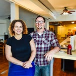 Kate Fischer and Nick Dysart sit at their Redbrick Social Media work stations in their downtown Marion loft/office. They said they maintain a schedule that allows them time to step away from work to do other tasks.