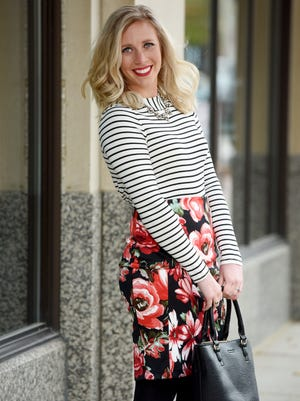 Henry + Martin green and red floral skirt, $38; black and white striped top, $32; black suede bootie, $38; statement necklace, $24; black tote, $52 Model: Katie Murphy