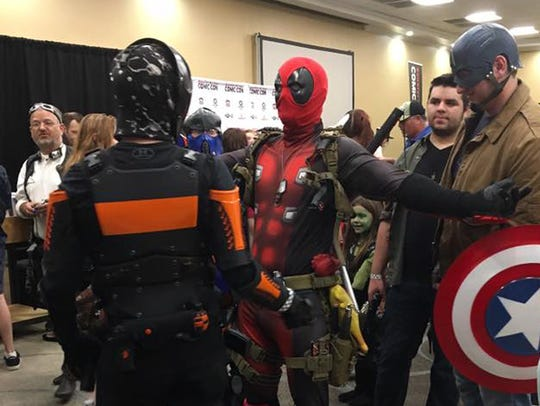 Attendees arrive in costume at Comic-Con 2017.