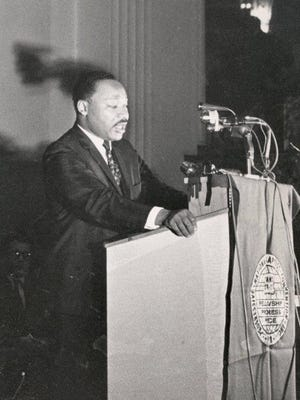 The Rev. Martin Luther King Jr. addresses the Hilton Cincinnati Netherland Plaza on Sept. 8, 1967. Speaking to delegates of the Progressive National Baptist Convention, King denounced the war in Vietnam for diverting attention and resources from the war on poverty.