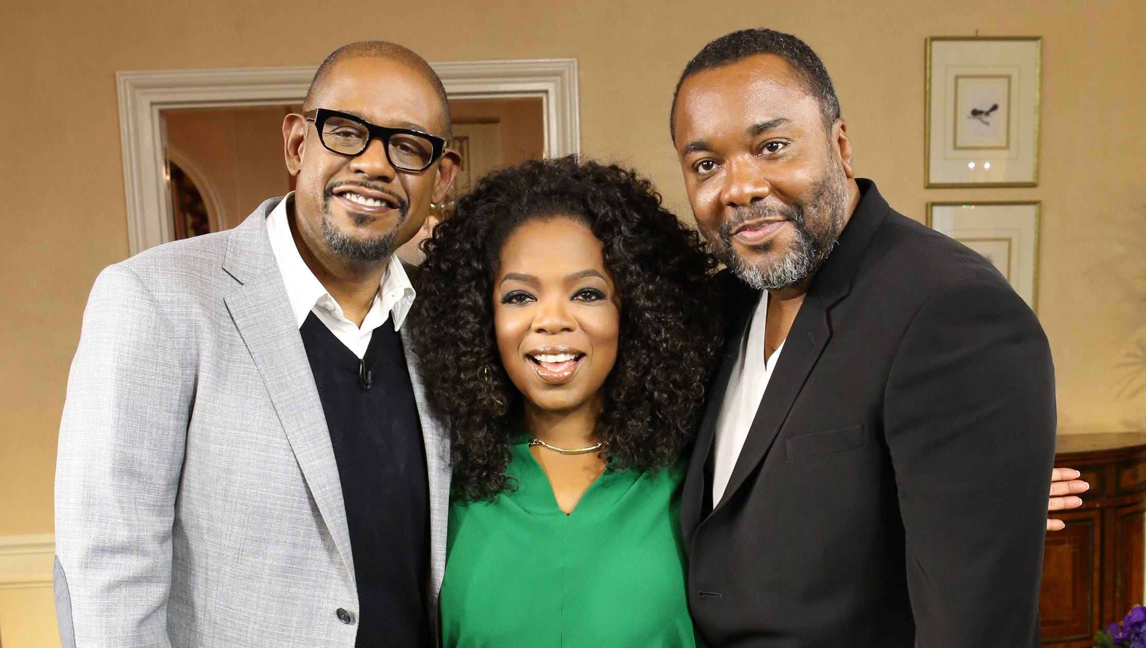 Oprah is casual and chic in lucky green while hanging out with Whitaker and Daniels in NYC on Aug. 1.