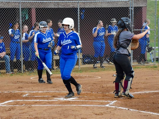 Fort Defiance's Katelyn Neighbors scores a run the first inning of the Indians' game against Stuarts Draft  on Wednesday, April 27, 2016, in Stuarts Draft.