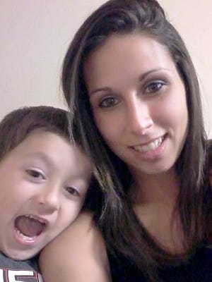 Crystal Santana, 24, with her 5-year-old son, Iziah Russell.