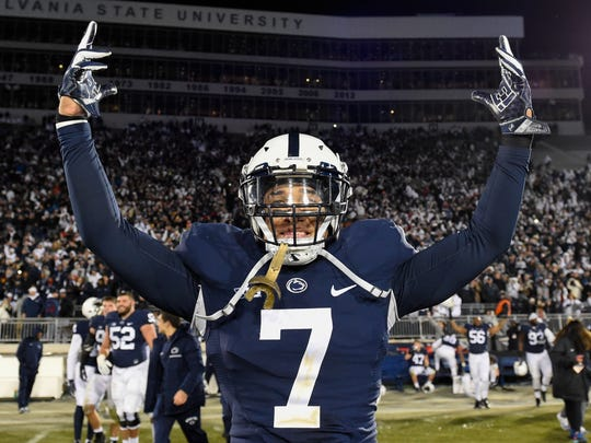 Penn State Nittany Lions safety Koa Farmer celebrates following the game against the Michigan State Spartans.