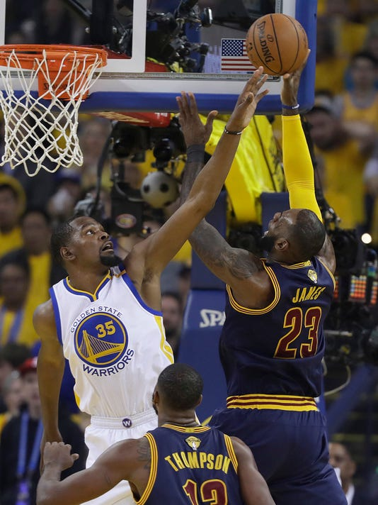 Cleveland Cavaliers forward LeBron James (23) shoots against Golden State Warriors forward Kevin Durant (35) during the first half of Game 1 of basketball's NBA Finals in Oakland, Calif., Thursday, June 1, 2017. (AP Photo/Marcio Jose Sanchez)