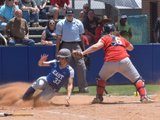 Pineville's Rebecca Martin (33, left) scores against St. Thomas More's Bailey Hemphill (16, right) in the East vs. West LHSCA All-Stars softball game held Saturday at Louisiana College.