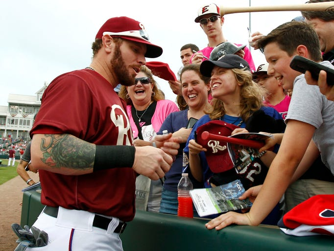 May 16: Hamilton  signs autographs before playing for
