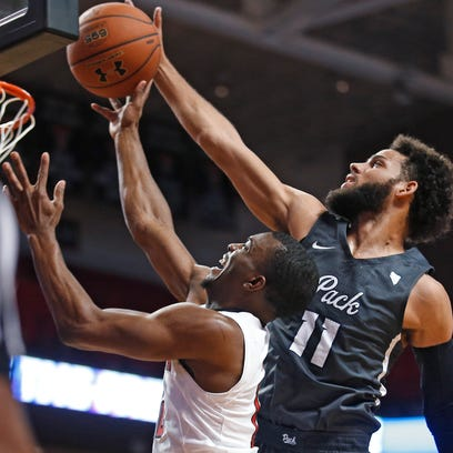 Nevada's Cody Martin tries to block a shot by Texas