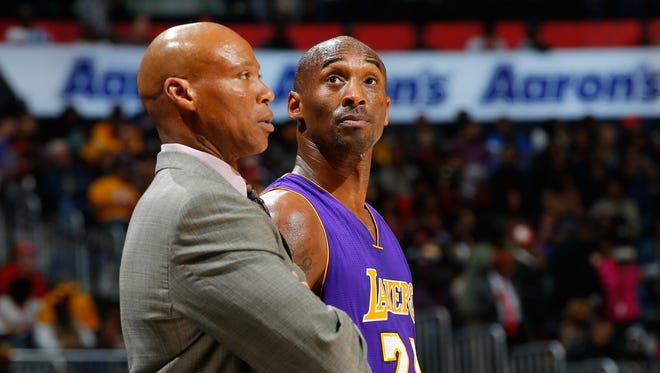 Kobe Bryant of the Los Angeles Lakers converses with Byron Scott during a December game in Atlanta.