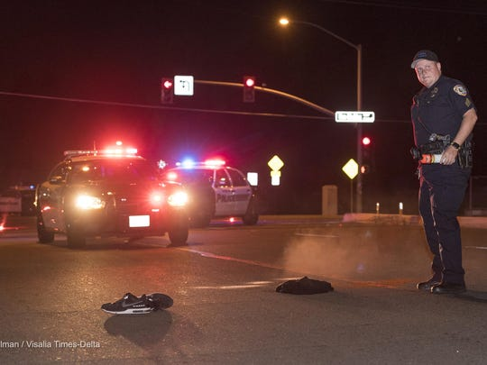 Visalia Police investigate a hit and run collision between a truck and a pedestrian on Walnut Avenue at Ben Maddox Way on Tuesday, May 9, 2017. The pedestrian was transported to a local hospital with head injuries after being struck in the crosswalk by a truck just before 9:30 p.m.