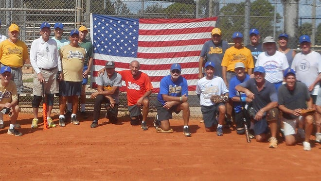 Members of the Jupiter Senior Softball League show their pride and recent tribute to America's working men and women.