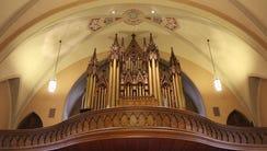 Trinity's historic 1879 Schuelke pipe organ is framed