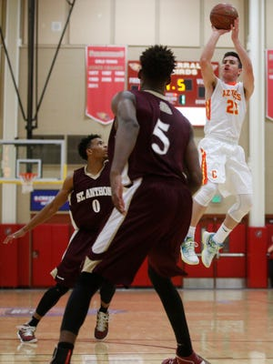 Corona del Sol guard Alex Barcello shoots a 3-pointer during the Hoophall West Tournament against St. Anthony (N.J.) at Chaparral High School in Scottsdale on December 18, 2015.