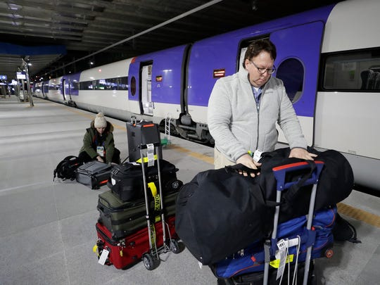 Milwaukee Journal-Sentinal photographer Mark Hoffman and USA TODAY Sports Images photo editor Shanna Lockwood stack their luggage Wednesday at the train station in Gangneung, South Korea. The two, along with Dan Powers, were heading to an awaiting van to take them to the Gangneung Media Village. Dan Powers/USA TODAY Sports Images