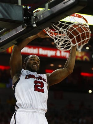 Preston Knowles gets loose for a dunk against Providence at the KFC Yum Center. March 2, 2011.