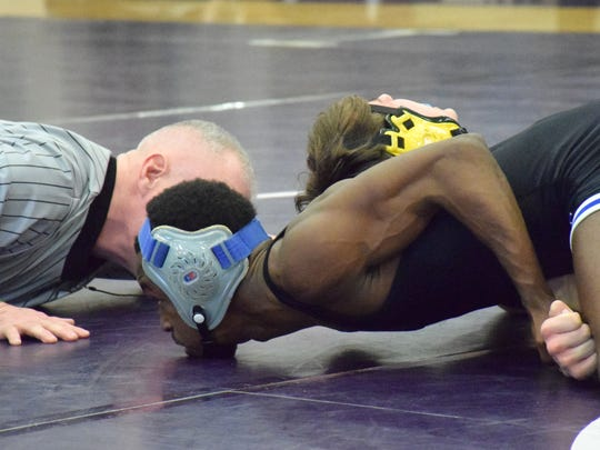 Robert E. Lee's Ta' Strother picks up back points against Bruton's Caleb Filicko during their 113-pound final at the Region 2A East wrestling championships on Saturday, Feb. 11, 2017, at Strasburg High School in Strasburg, Va. Strother won on a second-period pin.