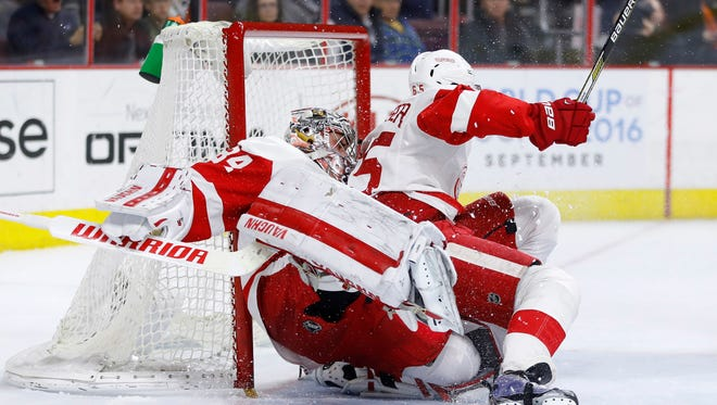 Red Wings defenseman Danny DeKeyser, right, collides with Petr Mrazek during the second period of Tuesday's loss in Philadelphia.