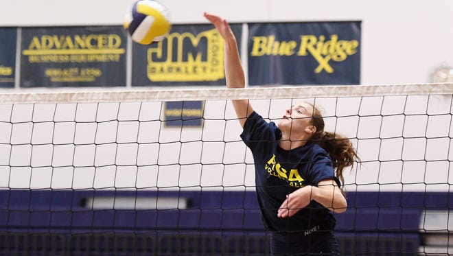 Asheville Christian Academy's Kate Condra spikes the ball during practice September 5, 2017.