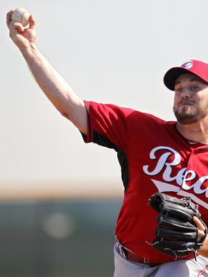 Reds relief pitcher J.J. Hoover throws during live batting practice at spring training, Thursday, Feb. 26, 2015.