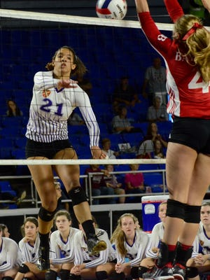 Father Ryan's Lauren Dorrell (21) attempts a kill over Baylor's Jane Wilson (4) during the state volleyball tournament.