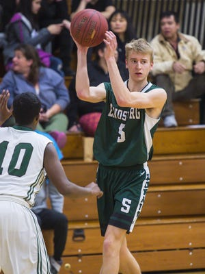 Enosburg's Calvin Carter, right, passes the ball against Winooski earlier this season.