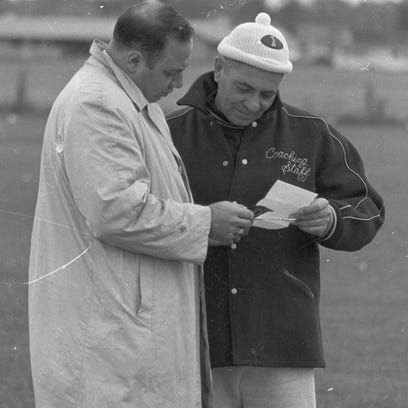 Green Bay Packers business manager Jack Vainisi, left,