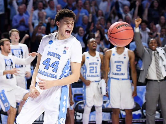 UNC forward Justin Jackson (44) reacts after dunking the ball during the 2nd round of the NCAA Tournament at Bon Secours Wellness Arena in downtown Greenville on Sunday, March 19, 2017.
