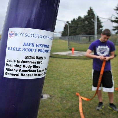 Alex Fischer stands near a piece of pole vault training equipment he designed for his Eagle Scout project at Albany High School.