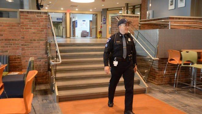 Kellogg Community College Public Safety Sgt. Marc Pierce walks through the college student center.
