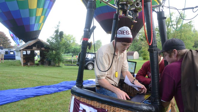 Christopher Cliver of Lewisville, Texas, was wearing a stocking cap before launching his balloon Friday.