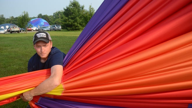 Joe Zvada squeezes air from his balloon.
