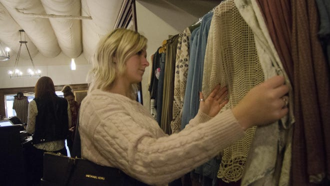 Shoppers check out the best deals at Luxe Lizzies in downtown Richmond, Ind. on Small Business Saturday, Nov. 26, 2016.
