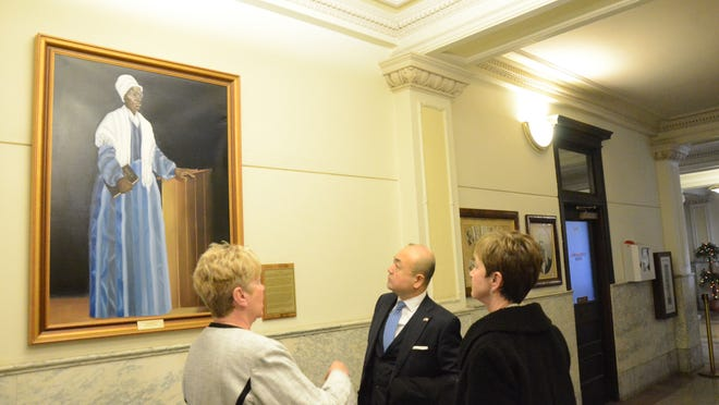 Mayor Deb Owens, left, discusses a portrait of Sojourner Truth in Battle Creek City Hall with Kazuyuki Katayama, consul-general of Japan in Detroit and Jan Frantz of Battle Creek Unlimited