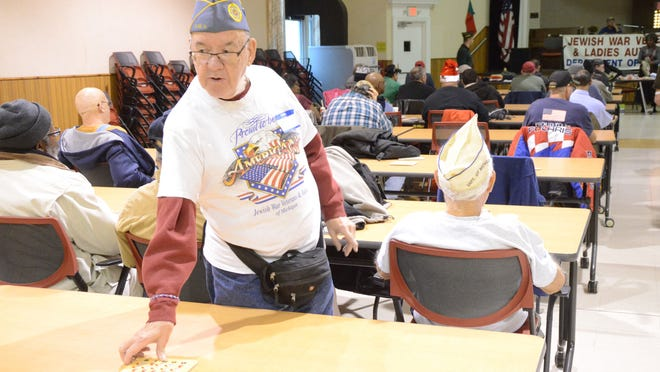 Jerry Order of Oak Park checks a winning bingo card Thursday.