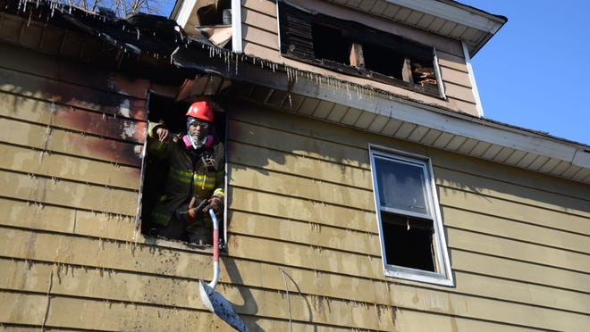 Lt. Quincy Jones was searching for the cause of the fire in the second floor bedroom.