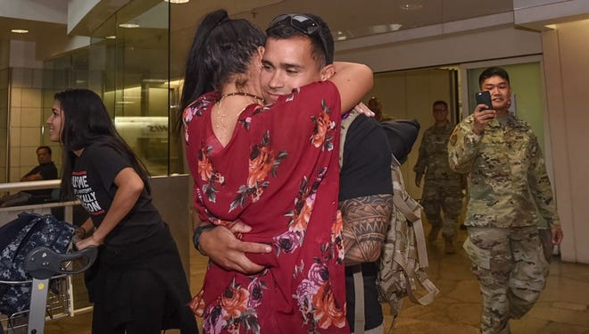 Army Reserve Staff Sgt. Osvaldo Canino is welcomed by his wife, Yaliz Carrasquillo, Wednesday at the A.B. Won Pat Guam International Airport after serving a nine month tour in Afghanistan.