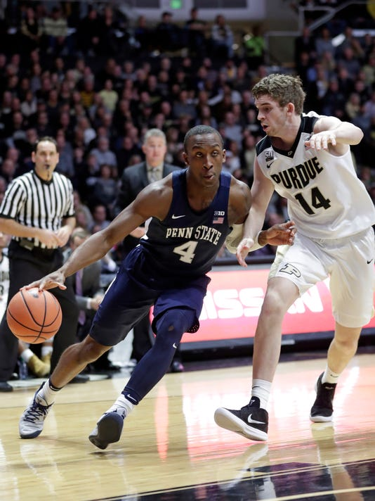 Penn State guard Nazeer Bostick (4) drives on Purdue guard Ryan Cline (14) in the first half of an NCAA college basketball game in West Lafayette, Ind., Sunday, Feb. 18, 2018. (AP Photo/Michael Conroy)
