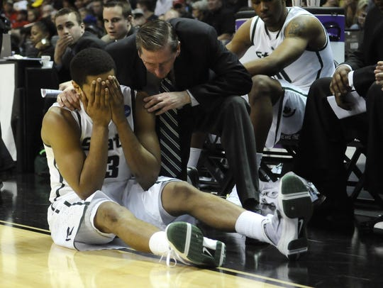 Michigan State's Chris Allen reacts near the bench