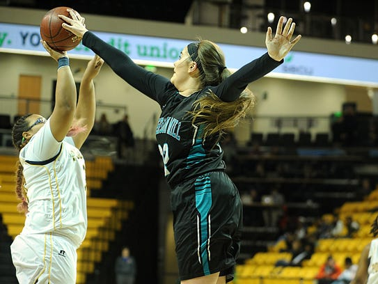 Patterson Mill's Lucie Passwater blocks the shot of