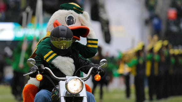 Nov 12, 2016; Eugene, OR, USA; Oregon Ducks mascot rides on a motorcycle before the game against the Stanford Cardinal at Autzen Stadium. Mandatory Credit: Scott Olmos-USA TODAY Sports