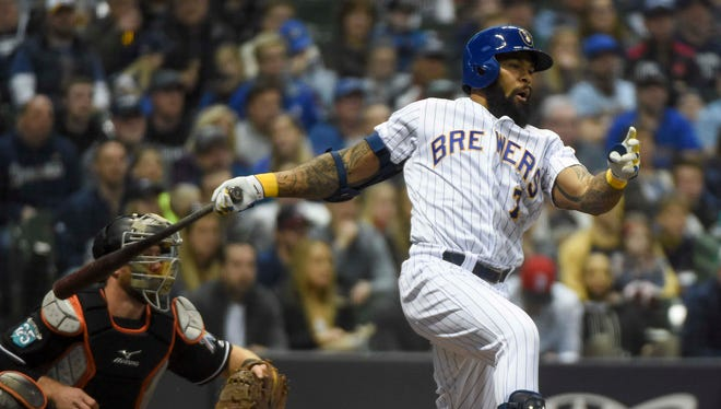 Brewers first baseman Eric Thames drives in a run against the Marlins with a single in the fourth inning.
