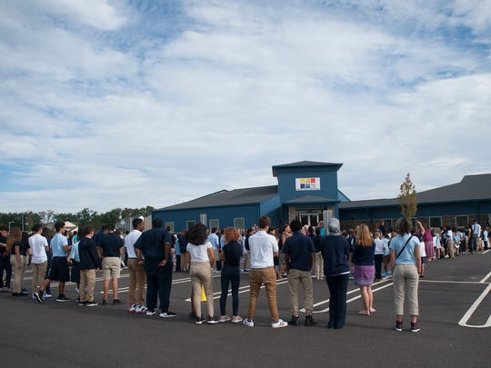 Students join in during the ribbon-cutting for the new Vineland Public Charter School.