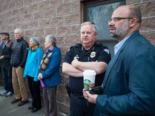 Islamic Center of Fort Collins President Tawfik AboEllail speaks to a Fort Collins Police Chief John Hutto before a rally to show support of the Islamic community on Sunday, March 25, 2017. The center was vandalized in the early hours of Sunday morning with broken windows and a bible thrown into the prayer room.