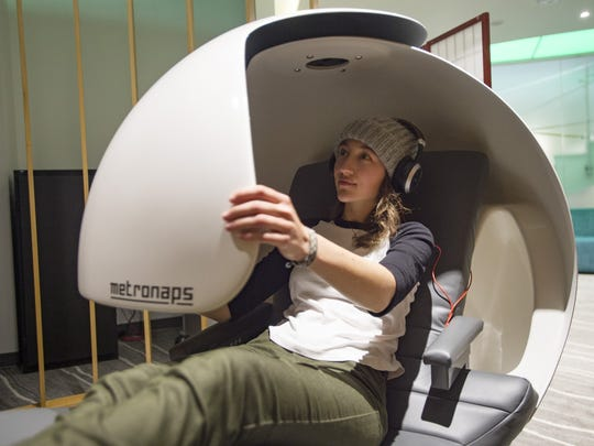 Allie Ruckman climbs into a relaxation pod at the CSU Health and Medical Center on Tuesday, January 16, 2018. The device, open to CSU students, staff and faculty, allows for 20 minutes of relaxation with noise-canceling headphones and a comfortable seat.